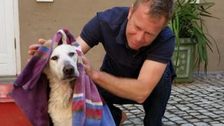 Andrew Harding with his dog, Lily