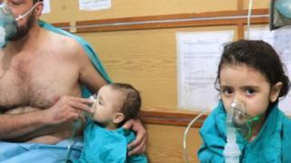 man and child receiving treatment in Aleppo following reported chemical attack