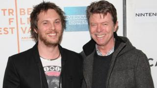 Duncan Jones and his father David Bowie at a film premier in 2009