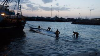 Wrecked boat which was carrying migrants is pulled into Zuwara port, Libya (27 August)