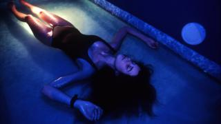 Woman lying down in flotation tank