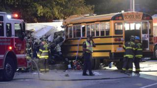 Rescue officials at the scene of an early morning collision between a school bus and a commuter bus in Baltimore