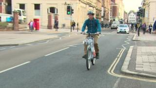 Someone riding an electric bike in Exeter.