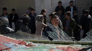 An Afghan man looks on at the site of a suicide car bombing in Kabul on March 1, 2017