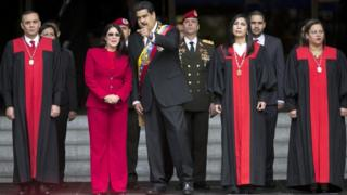 Nicolas Maduro speaks to first lady Cilia Flores next to Supreme Court judges