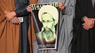 Iraqi Shia Muslims protest the death of Sheikh Nimr al-Nimr