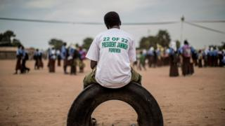 A supporter of the Gambian incumbent President Yahya Jammeh waits at a venue where an electoral meeting in Schur Alagie, The Gambia - Monday 28 November 2016