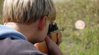 Boy with air gun