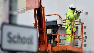Worker carrying out repairs at Edinburgh school