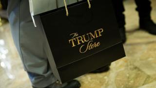 A visitor carries a 'Trump Store' bag at Trump Tower, November 22, 2016 in New York City.