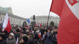 Protesters attend an anti-government demonstration in Warsaw, Poland, 17 December 17, 2016.