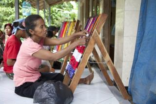 Disabled villagers weave doormats to make a living