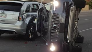 A self-driven Volvo SUV owned and operated by Uber Technologies Inc. is flipped on its side after a collision in Tempe, Arizona, U.S. on March 24, 2017.