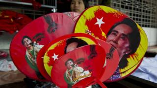 Various fans with portraits of Myanmar opposition leader Aung San Suu Kyi are seen for sale outside the National League for Democracy (NLD) party headquarters in Yangon on November 11, 2015