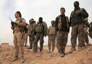 Syrian Democratic Forces (SDF) fighters gather during an offensive against Islamic State militants in northern Raqqa province, Syria, 8 February 2017.