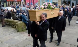 Coffin being carried