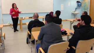Johanna teaches immigrants in a basic classroom