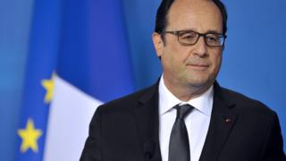 French President Francois Hollande holds a press conference at the end of talks over the Greek debt crisis in Brussels on July 13, 2015.