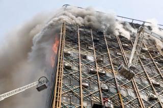 Iranian firefighters attempt to control fire at the Plasco building in Tehran, <a href=