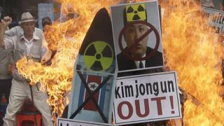 Image of North Korean leader Kim Jong-un is burned by South Korean protesters during rally denouncing North Korea's latest nuclear test in Seoul, South Korea. 10 Sept, 2016