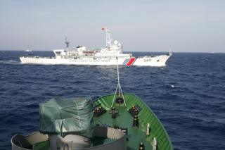 A Chinese Coast Guard ship (top) is seen near a Vietnam Marine Guard ship in the South China Sea, about 210 km (130 miles) off shore of Vietnam, in this 14 May 2014 file photo