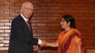 """Indian Foreign Minister Sushma Swaraj(R)and Pakistan""""s Foreign Affairs Advisor Sartaj Aziz shake hands during a meeting on the sidelines of The South Asian Association for Regional Cooperation(SAARC)foreign minister""""s meeting in Pokhara, some 200kms west of Kathmandu on March 17, 2016"""