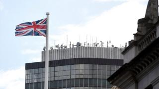 A Union Jack flies in front of the Millbank Tower by the River Thames where RT is based in London, 17 October