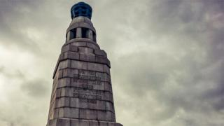 The brazier at the top of the Dundee war memorial is lit to commemorate the Battle of Loos