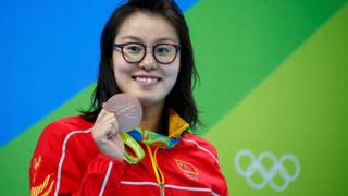 Fu Yuanhui (CHN) of China (PRC) pose with her medal in the Women