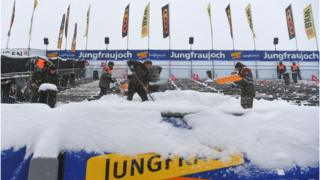 Staff clean the tribune at the finish area of the men's Alpine downhill race of the FIS Alpine Skiing World Cup at the Lauberhorn, in Wengen, on 14 January 2017.