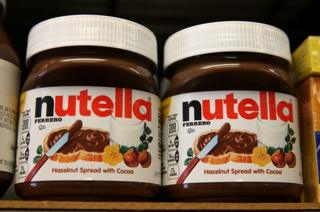 This picture shows jars of Nutella on a shelf at a market in San Francisco, California, on August 18, 2014