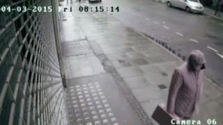 A still image taken from CCTV footage of John Collins walking past Tobi Gem Setting in Hatton Garden