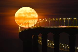 A full moon rising over the Re Island Bridge in Rivedoux