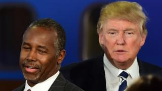 In this September 16, 2015 file photo, Republican presidential hopefuls Ben Carson and Donald Trump participate in the Republican Presidential Debate at the Ronald Reagan Presidential Library in Simi Valley, California.