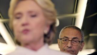 John Podesta aboard 'Hill Force One', the nickname for Clinton's campaign plane