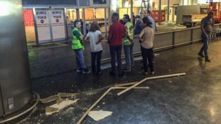 Workers assess damage at Ataturk airport (29 Jun)