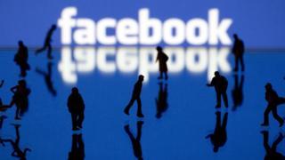 Facebook logo and people walking