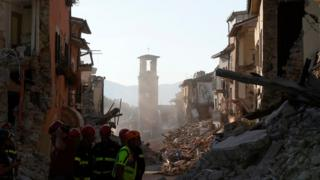 Firefighters work along the main street in Amatrice, central Italy, Saturday, 27 August 2016