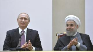 Russian President Vladimir Putin and his Iranian reflection Hassan Rouhani attend a news discussion in Tehran