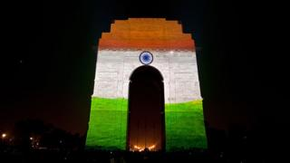 3D mapping projections display the Indian tricolor national flag on the India Gate