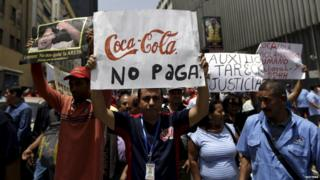 Union members of Polar's beer factory take part in a demonstration in Caracas 2 July 2015