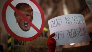 Demonstrators hold up placards during a protest outside Downing Street against U.S. President Donald Trump's ban on travel from seven Muslim countries on January 30, 2017 in London, England. President Trump signed an executive order on Friday banning immigration to the USA from seven Muslim countries. This led to protests across America and, today, in the UK, a British petition asking for the downgrading of Trump's State visit passed one million signatures this morning.