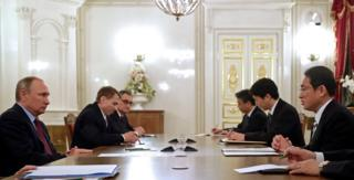 Russian President Vladimir Putin (left) meets with Japanese Foreign Minister Fumio Kishida (right) in St Petersburg, Russia, 2 December 2016.
