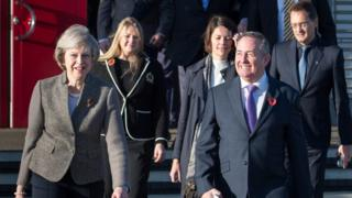 Theresa May and Liam Fox depart for India trade mission