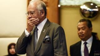 n this picture taken on July 8, 2015 Malaysian Prime Minister Najib Razak (L) gestures as he arrives along with Deputy Prime Minister Muhyiddin Yassin (R) to take part in an event for new government interns at the Prime Minister's office in Putrajaya.