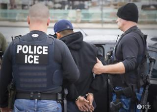 US Immigration and Customs Enforcement (ICE) agents detain a suspect during an enforcement operation on 7 February, 2017 in Los Angeles.
