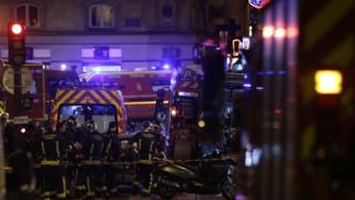 Rescuers move a victim of an attack in the French capital Paris, on November 13, 2015.