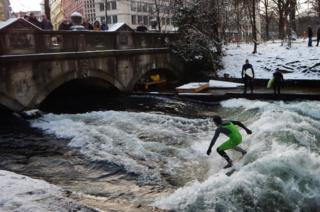 Surfers ride the Eisbach canal
