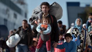 A migrant man and daughter arrives in the Greek port of Piraeus