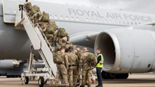 Troops board RAF transport aircraft